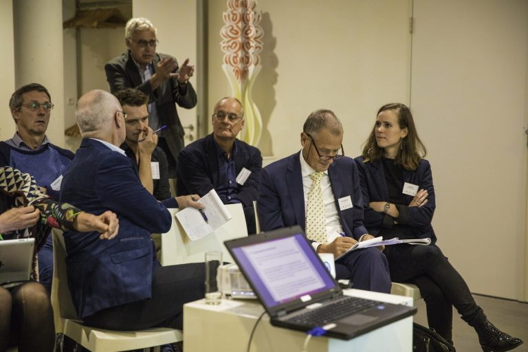Jan van Rheenen (second from the right) at a symposium dedicated to his retiral from Kadaster. Jan Spijkerboer is not in the picture.